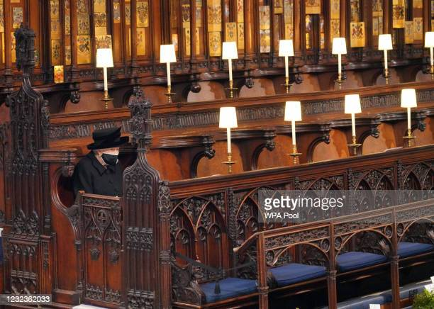 Queen Elizabeth II takes her seat during the funeral of Prince Philip, Duke of Edinburgh, at St George's Chapel at Windsor Castle on April 17, 2021...