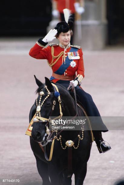 Queen Elizabeth II taking the salute outside Buckingham Palace at the Trooping the Colour ceremony in London on June 11 1983