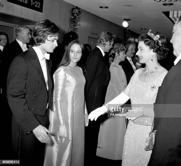 Queen Elizabeth II talking with Olivia Hussey and Leonard Whiting young stars of 'Romeo and Juliet' prior to the Royal Film Performance at the Odeon...