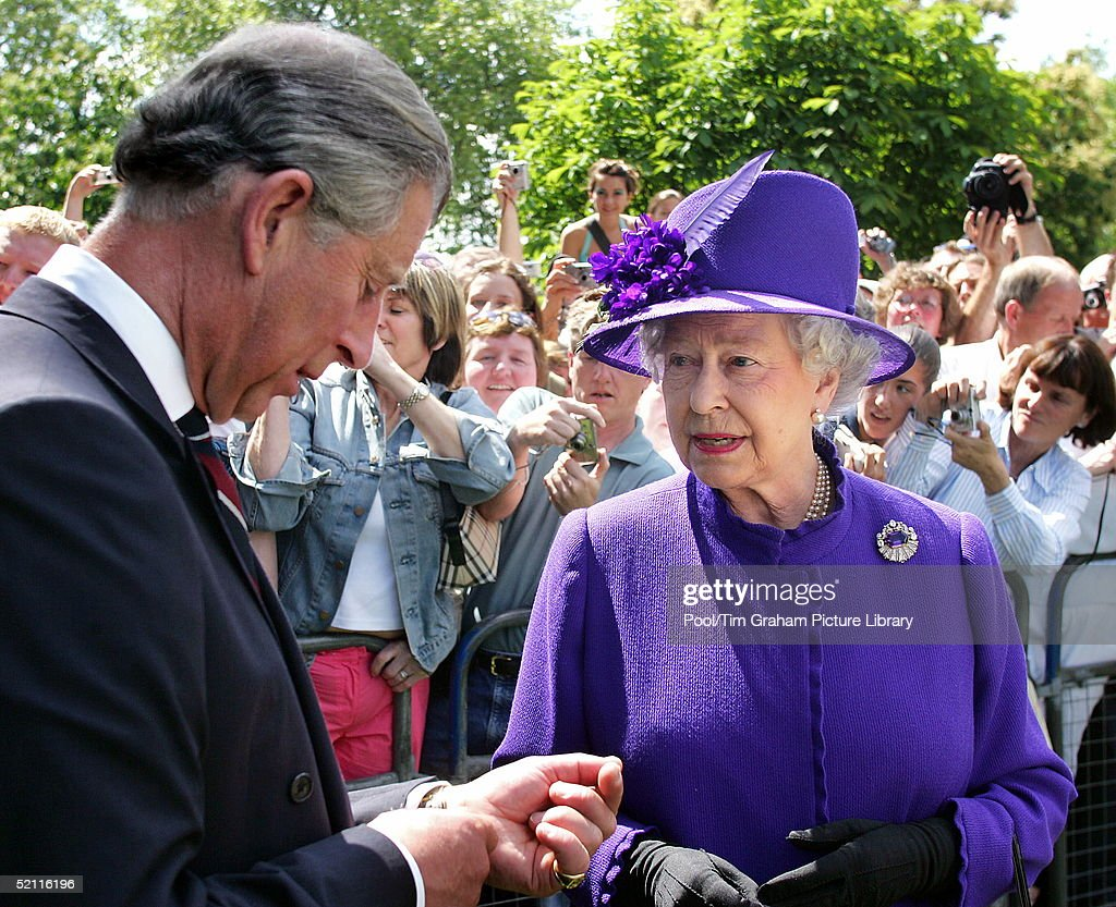Queen Elizabeth II Talking With The Duke Of Edinburgh, Prince Charles, At The Opening Of A Fountain Built In Memory Of Diana, Princess Of Wales In London's Hyde Park.