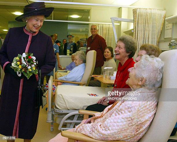 Queen Elizabeth II talks to 101-year-old Pearl Bailey and her daughters Adrienne Bailey and Valerie Bailey as she opens the New Norfolk and Norwich...