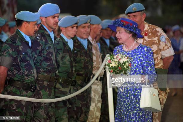 Queen Elizabeth II talks to a contingent of Argentinian soldiers who are on peace keeping duty in the UN buffer zone with British soldiers at the...