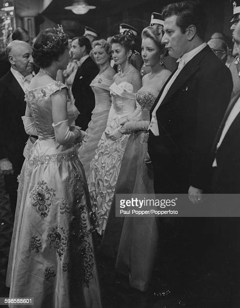 Queen Elizabeth II talks to a lineup of film stars after the Royal Command Performance of the film 'To Catch a Thief' Peter Ustinov June Thorburn...