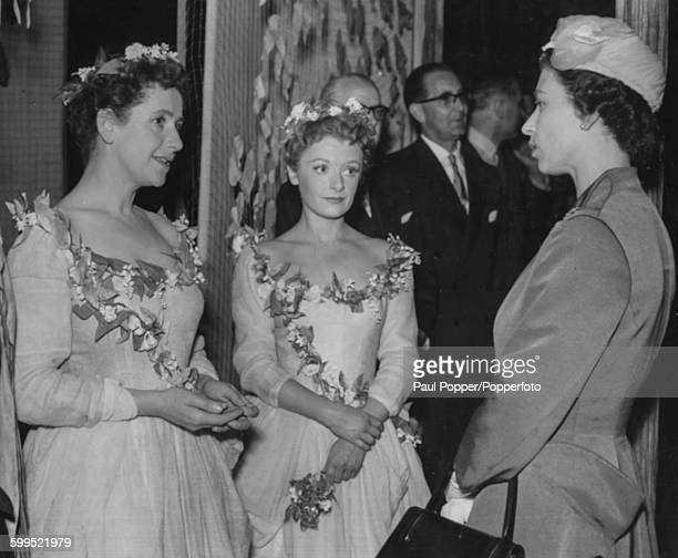 Queen Elizabeth II talks to actresses Dame Peggy Ashcroft and Jane Wenham after watching a performance of William Shakespeare's play 'As You Like It'...