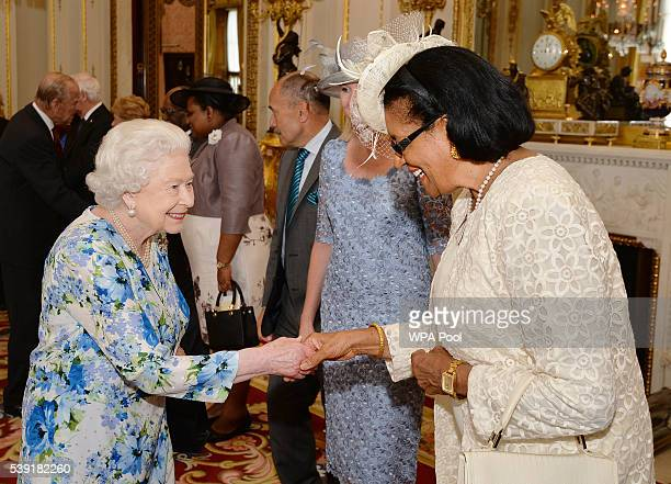 Queen Elizabeth II talks to Dame Cecile La Grande of Grenada during a reception during a reception ahead of a lunch at Buckingham Palace on June 10,...