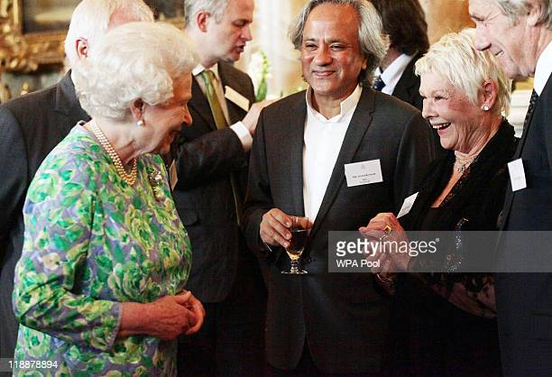 Queen Elizabeth II talks to Dame Judi Dench and artist Anish Kapoor during a reception for the Praemium Imperiale Awards at Buckingham Palace on July...