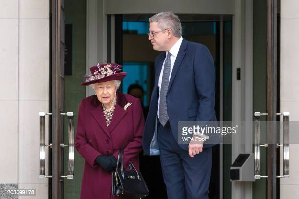 Queen Elizabeth II talks to Director General Andrew Parker as she leaves after a visit to the headquarters of MI5 at Thames House on February 25 2020...