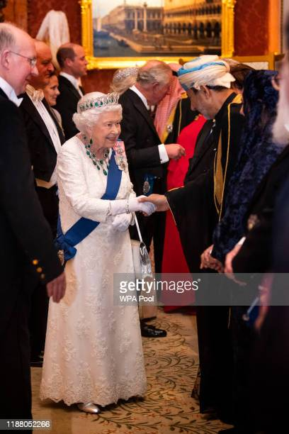 Queen Elizabeth II talks to guests at an evening reception for members of the Diplomatic Corps at Buckingham Palace on December 11 2019 in London...
