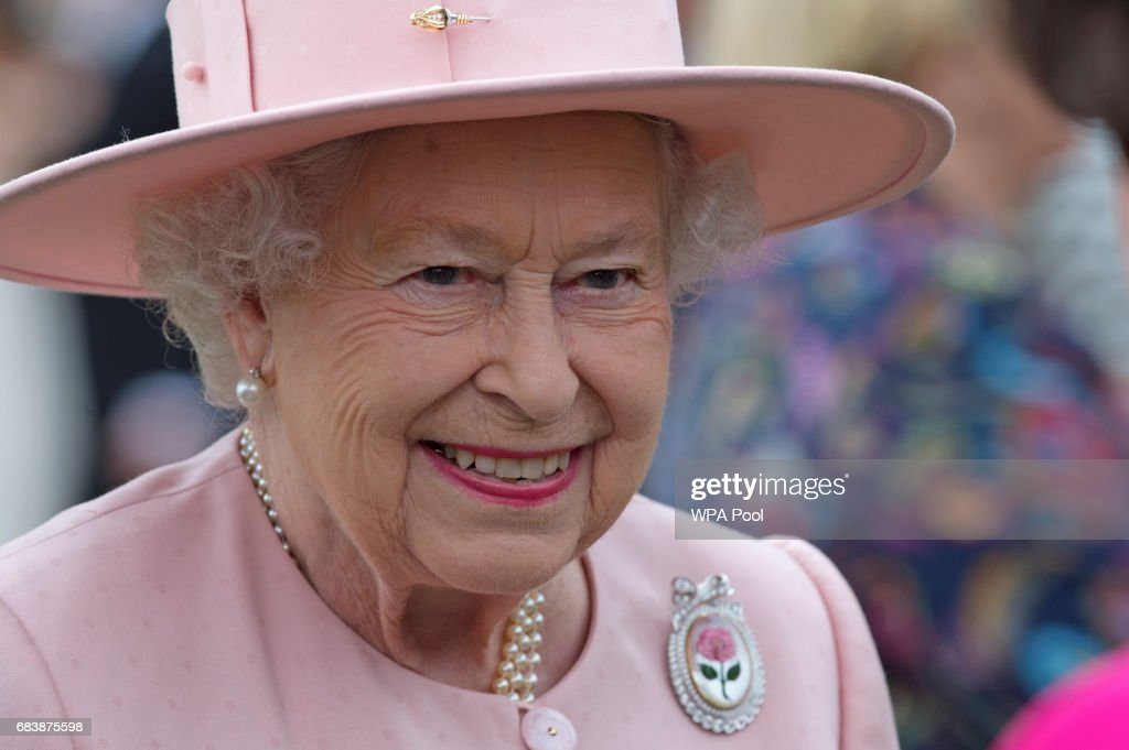 Queen Elizabeth II talks to guests during a garden party at Buckingham Palace on May 16, 2017 in London, England.