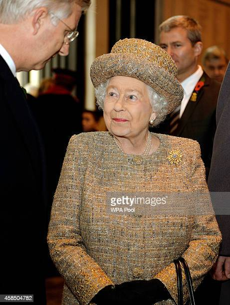 Queen Elizabeth II talks to King Philippe of Belgium after the opening of the Flanders' Fields Memorial Garden on November 6 2014 in London England