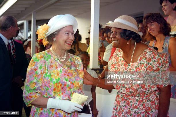 Queen Elizabeth II talks to locals at the Ronald Webster Park in Anguilla on her four day visit to the Caribbean