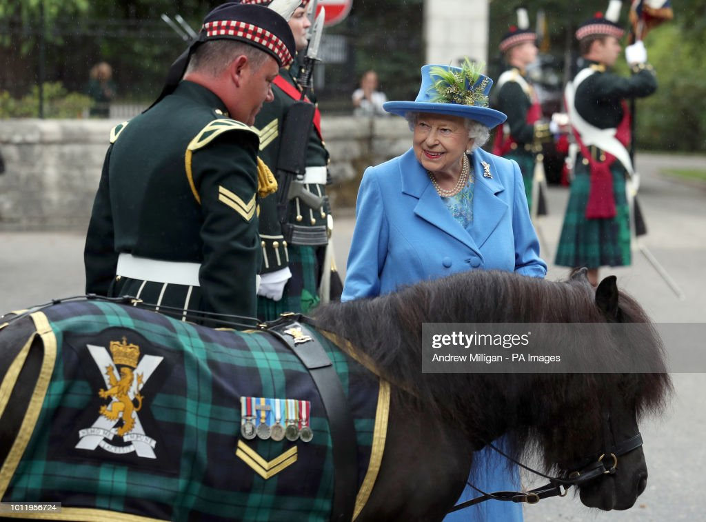 Queen Elizabeth II talks to Pony Major Mark Wilkinson with regimental mascot Cruachan IV as she inspects Balaclava Company, 5 Battalion The Royal Regiment of Scotland at the gates at Balmoral, as she takes up summer residence at the castle.