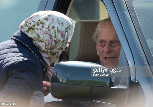 Queen Elizabeth II talks to Prince Philip Duke of Edinburgh in his car at the Royal Windsor Horse Show at Home Park on May 11 2018 in Windsor England