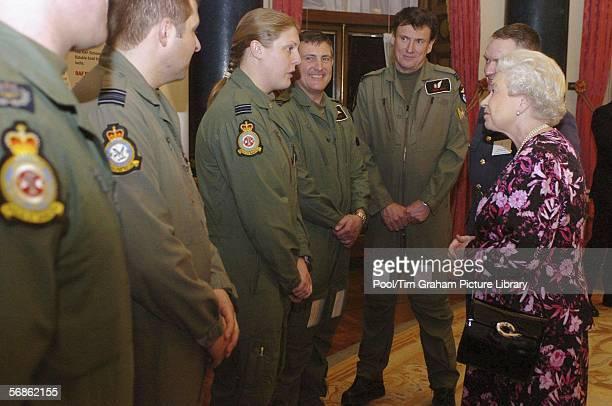 Queen Elizabeth II talks to Royal Air Force Flight Lieutenant Holly Steel in the Music Room inside Buckingham Palace on February 15 2006 in London...
