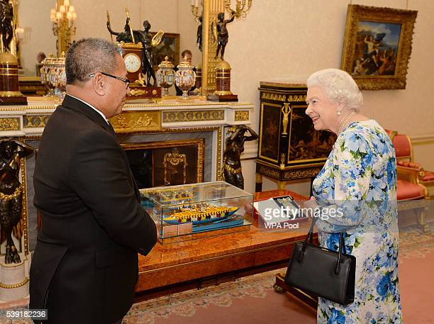 Queen Elizabeth II talks to Sir Iakoba Italeli of Tuvalu during a reception during a reception ahead of a lunch at Buckingham Palace on June 10, 2016...