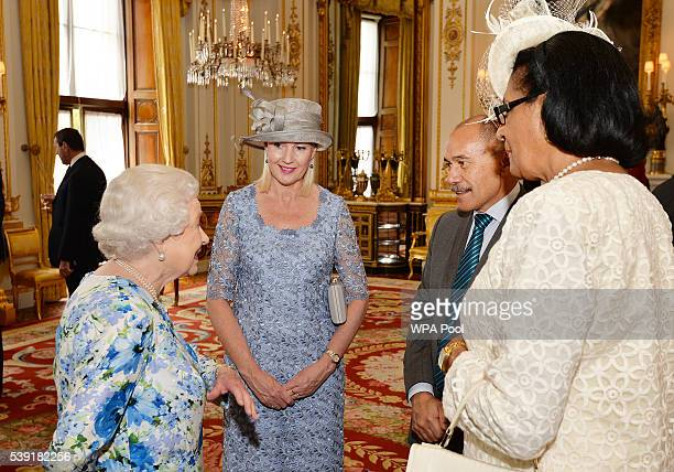 Queen Elizabeth II talks to Sir Jerry Mateparae of New Zealand and Dame Cecile La Grande of Grenada during a reception during a reception ahead of a...