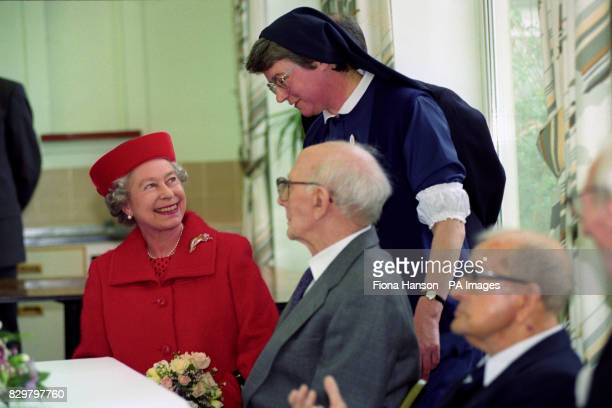 Queen Elizabeth II talks to Sister Maureen and Stanley Lewis at St David's Home for disabled ex-servicemen, which is celebrating its 75th anniversary.