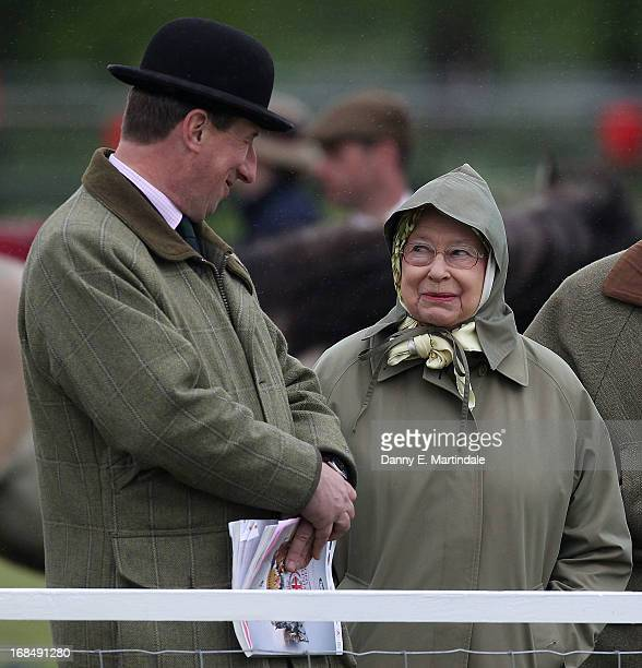 Queen Elizabeth II talks to the show chairman Stuart Cowen on day 3 of the Royal Windsor Horse Show on May 10 2013 in Windsor England