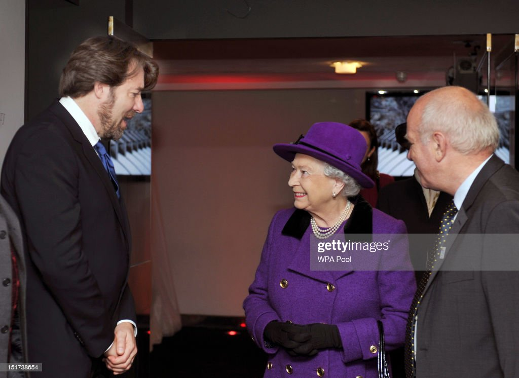 Queen Elizabeth II talks to TV presenter Jonathan Ross (L) after being introduced by Greg Dyke (R) during a visit to the British Film Institute on October 25, 2012 on the Southbank in London, England.
