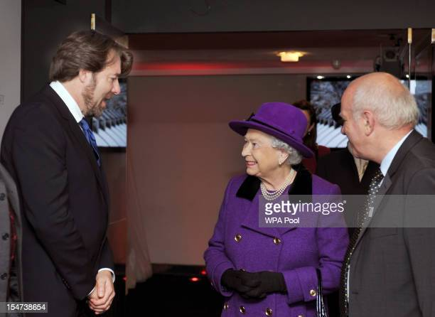 Queen Elizabeth II talks to TV presenter Jonathan Ross after being introduced by Greg Dyke during a visit to the British Film Institute on October 25...