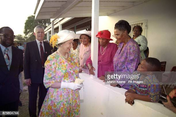 Queen Elizabeth II talks to wellwishers during a walkabout in Ronald Webster Park on Anguilla