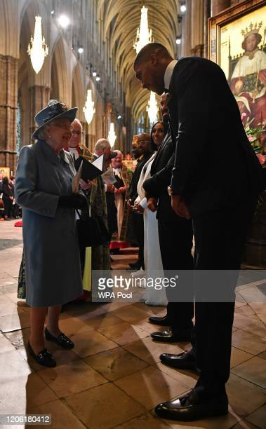 Queen Elizabeth II talks with British boxer Anthony Joshua as she leaves after attending the Commonwealth Day Service 2020 on March 9 2020 in London...