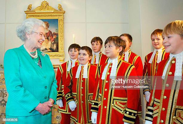Queen Elizabeth II talks with choristers from Her Majesty's Chapel Royal who appear in her Christmas Day broadcast to the Commonwealth in the Chapel...