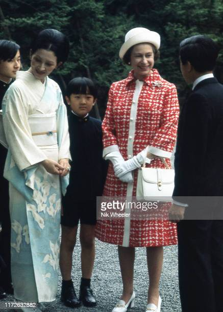 Queen Elizabeth II talks with Crown Prince Akihito and Crown Princess Michiko and their children during her one and only visit to Japan in 1975