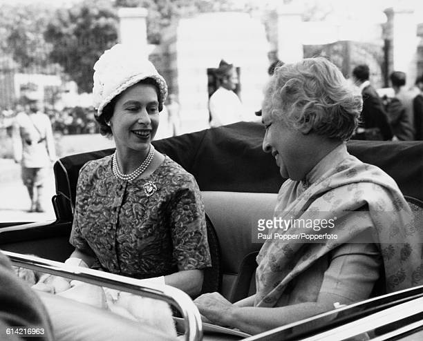 Queen Elizabeth II talks with Indian politician and diplomat Vijaya Lakshmi Pandit in the back of an open top car as they drive from Jaipur House in...