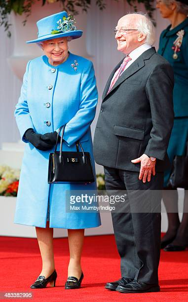 Queen Elizabeth II talks with Irish President Michael D Higgins during his ceremonial welcome on April 8 2014 in Windsor England This is the first...