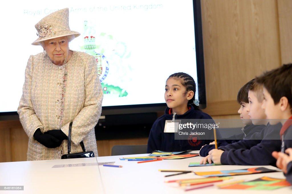 Queen Elizabeth II talks with local school children as she and Prince Philip, Duke of Edinburgh open a new development at The Charterhouse at Charterhouse Square on February 28, 2017 in London, England.