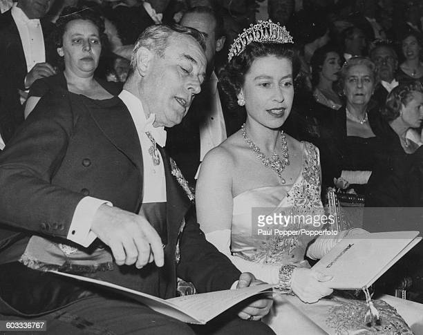 Queen Elizabeth II talks with Louis Mountbatten 1st Earl Mountbatten of Burma as they attend the premiere of the film 'Dunkirk' at the Empire Cinema...