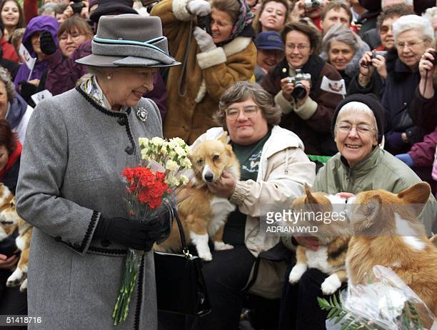 Queen Elizabeth II talks with members of the Manitoba Corgi Association during a visit to Winnipeg 08 October 2002 The queen making her 20th trip to...