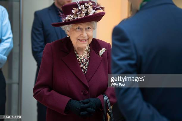 Queen Elizabeth II talks with MI5 officers during a visit to the headquarters of MI5 at Thames House on February 25 2020 in London England MI5 is the...