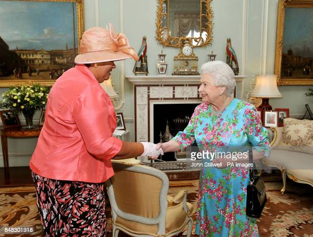 Queen Elizabeth II talks with Mrs Aloun NdombetAssamba the High Commissioner for Jamaica during a private audience at Buckingham Palace in central...