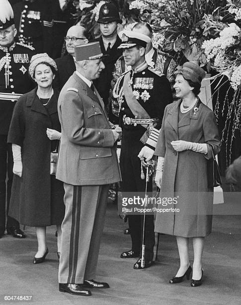 Queen Elizabeth II talks with President Charles de Gaulle of France with Prince Philip Duke of Edinburgh and Yvonne de Gaulle on left as the French...