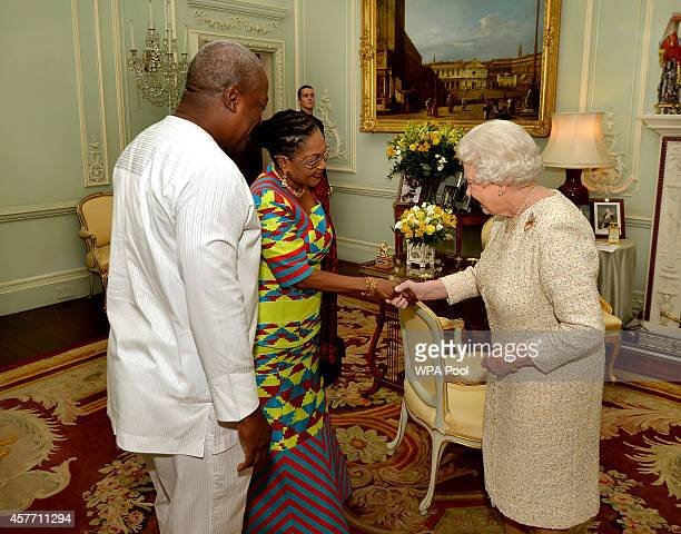 Queen Elizabeth II talks with President of Ghana John Dramani Mahama and his wife Lordina Mahama during a private audience at Buckingham Palace on...