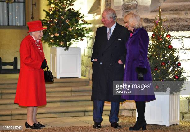 Queen Elizabeth II talks with Prince Charles, Prince of Wales and Camilla, Duchess of Cornwall as they wait to thank local volunteers and key workers...