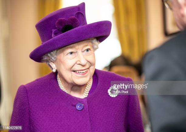 Queen Elizabeth II talks with residents in the new Appleton Lodge care facility run by the RBLI during a visit to the Royal British Legion Industries...