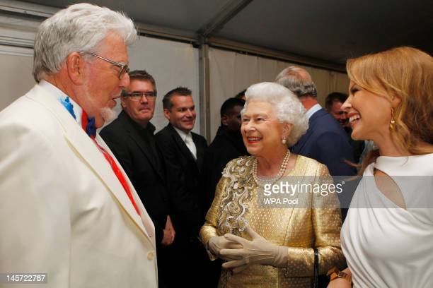 Queen Elizabeth II talks with Rolf Harris and Kylie Minogue backstage after the Diamond Jubilee Buckingham Palace Concert June 04 2012 in London...