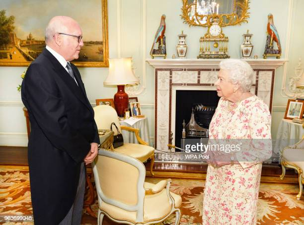 Queen Elizabeth II talks with the Honorable George Brandis the Australian High Commissioner to the United Kingdom during a private audience at...