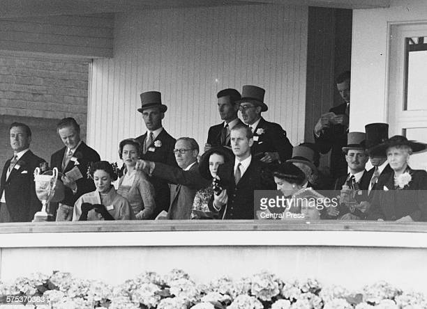 Queen Elizabeth II the Duke of Edinburgh Princess Margaret and her partner RAF Group Captain Peter Townsend in the Royal Box at Royal Ascot races in...