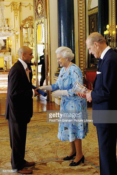 HM Queen Elizabeth II The Queen and her husband Prince Philip Duke of Edinburgh present Sikander Badat with the Queen's Award for Enterprise...
