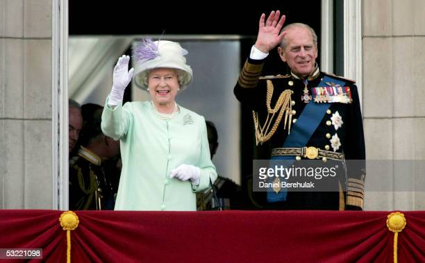 Queen Elizabeth II, The Queen, and Prince Philip, Duke of Edinburgh, watch the flypast over The Mall of British and US World War II aircraft from the...