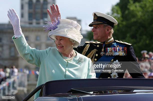 HM Queen Elizabeth II The Queen and Prince Philip the Duke of Edinburgh wave to the crowd as they leave the Recollections Of World War II...