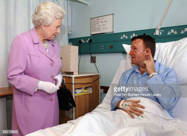 HM Queen Elizabeth II The Queen chats with Bruce Lait about damage to his hearing caused when he was caught in one of the explosions on the...