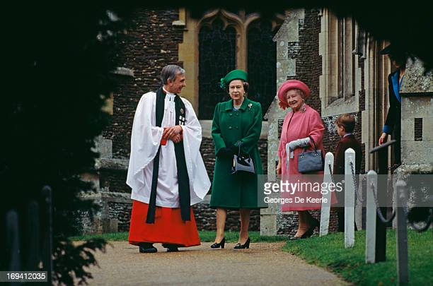 Queen Elizabeth II the Queen Mother and Prince William walking with the vicar of St Mary Magdalene Church on Christmas Day whilst the Royal Family...