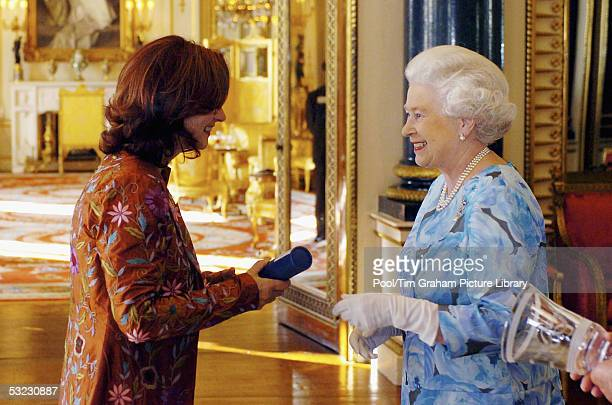 HM Queen Elizabeth II The Queen presents Diane Gowland Director at the Centre for Innovation and Partnerships at Newham College with the Queen's...