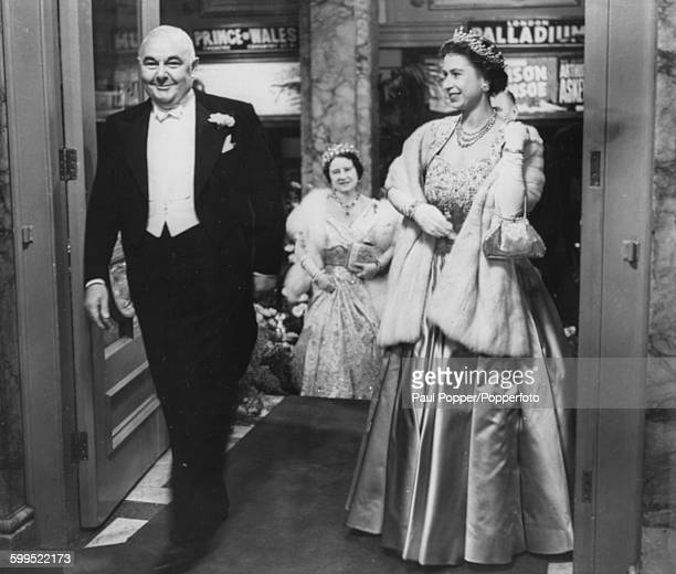Queen Elizabeth II theatre impressario Prince Littler and Queen Elizabeth the Queen Mother arrive together for the Royal Command Variety Performance...
