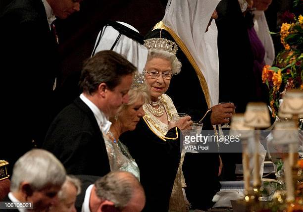 Queen Elizabeth II toasts Qatar's Emir Sheikh Hamad bin Khalifa alThani before a banquet in St George's Hall in Windsor Castle held during their...